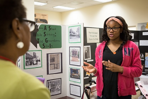 20170405-01-006 Student with Greensboro Taking a Stand exhibit.jpg
